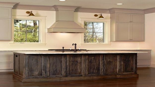 Tuscan style kitchen with crown moldings