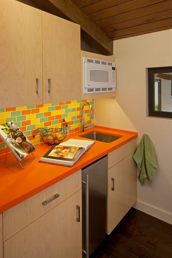 Orange Corian Countertop Kitchen - Susan Jay Design