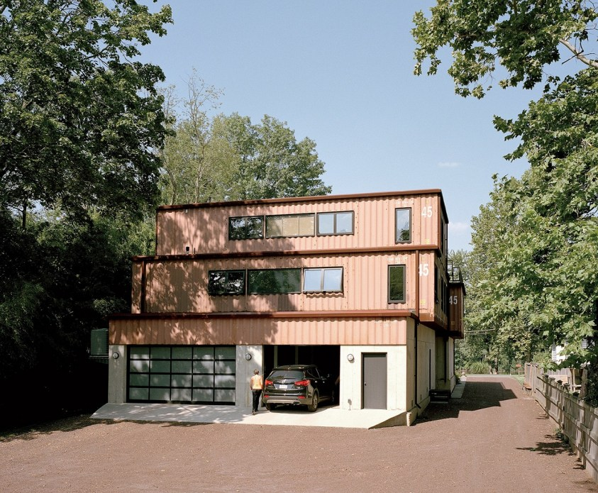 Shipping container house with garage