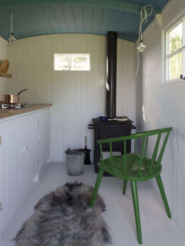 Shiplap cladding looks charming in A British Standard Kitchen in a Shepherd's Hut, and has the added benefit of keeping the little kitchen snug against the wind.