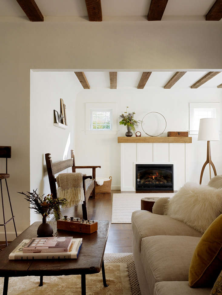 "Alison Davin of Jute in San Francisco says, ""Benjamin Moore's White Dove has a cult following in the white world. Its warm undertone has a universal appeal and works well in most spaces."" The designer used the color in the San Anselmo living room shown here. Photograph by Matthew Millman, courtesy of Jute."