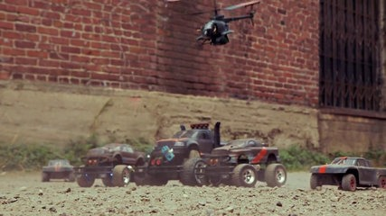 Action video pits laser-firing drones against remote-control cars… and a dog