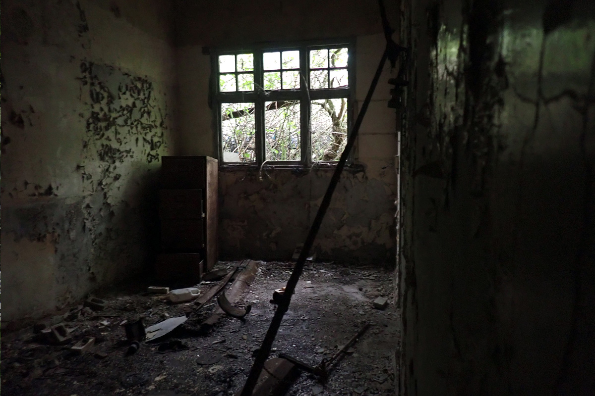 Derelict room with broken window