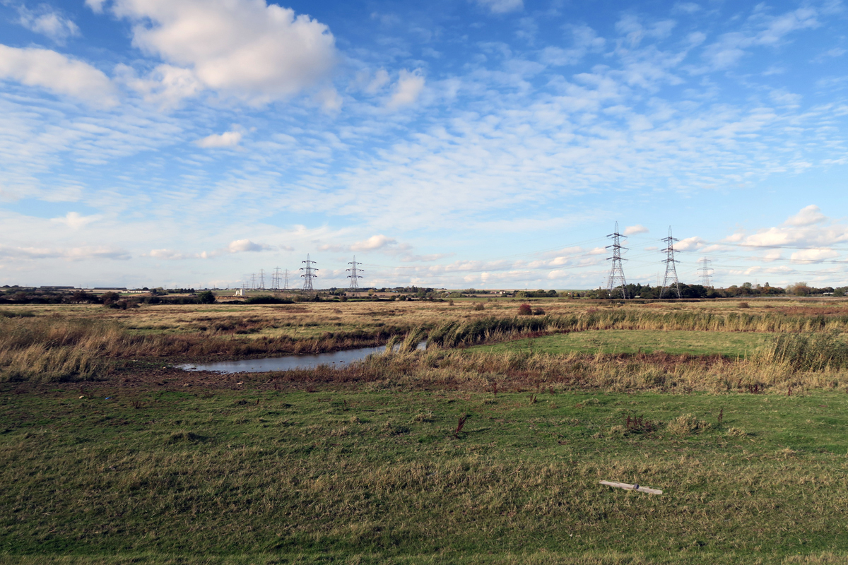 Looking inland as the path approaches the site of Kingsnorth Power Station