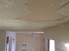 Laky roof in Burnaby causes cracked and delaminated ceilings