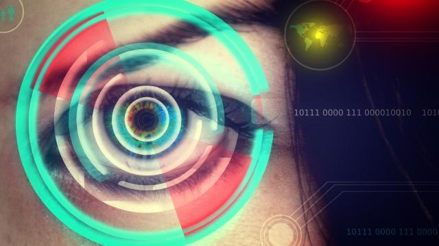 picture of an eye with green circles around and some ones and zeros on the right