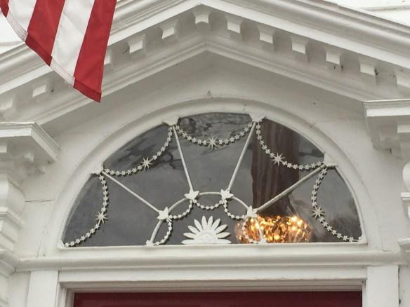Looking up at a beautiful fan window on Main Street in Essex