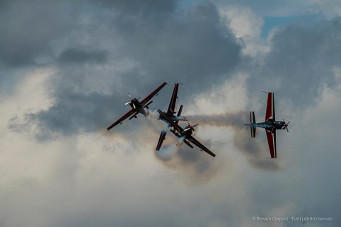 """Royal Jordanian Falcons"" on 4 single propeller Extra 300. Nikon D810, 400 mm (80-400.0 mm ƒ/4.5-5.6) 1/2000 sec ƒ/7.1 ISO 400"