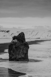 "The farallon emerging from the Black Sand Beach right at the entrance of the Reynisfjara lagoon. Nikon D810, 85 mm (85.0 ƒ/1.4) 1/25"" ƒ/5 ISO 64"