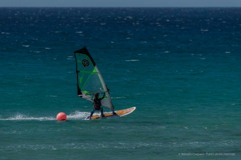 """The Only Game in Town: surfing in Tarifa. Nikon D750, 400 mm (80-400.0 mm ƒ/4.5-5.6) 1/1250"""" ƒ/5.6 ISO 100"""