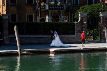 "A father escorts his daughter to church for her wedding. Murano, Venice Laguna, September 2018. Nikon D810, 120 mm (24-120 mm ƒ/4) 1/250"" ƒ/8 ISO 64"