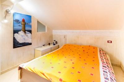 Camera da letto appartamento Andora
