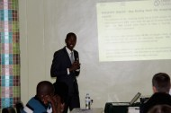 Innocent Mumararungu giving a presentation on behalf of Chance for Childhood, hosting organisation