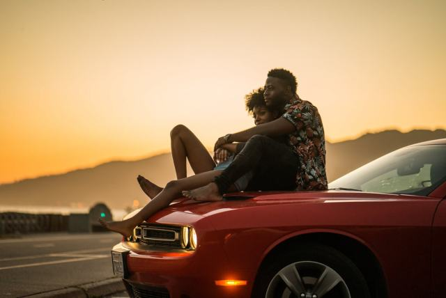 couple on a car hood on a romantic getaway