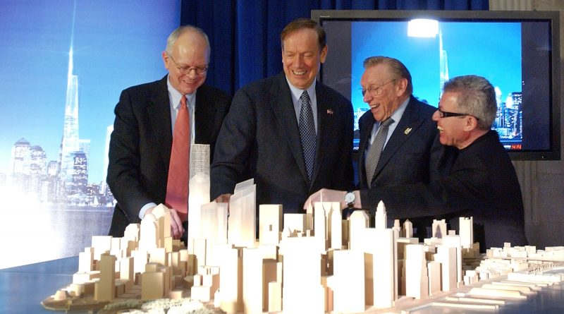 NEW YORK - DECEMBER 19: Architect and designer Daniel Libeskind (R) stands with WTC leaseholder Larry Silverstein (2nd-R),  New York State Governor George Pataki (3rd-R) and architect David Childs (R) as they look at a model of the re-built World Trade Center site December 19, 2003 at Federal Hall in New York City. The Freedom Tower will be built on the World Trade Center site and will rise 1,776 feet intio the sky becoming the world's tallest building. The building will contain 2.6 million square feet of office space on 60 stories and the top floors will house roof top restaurants and a public observation deck. (Photo by Stephen Chernin/Getty Images)