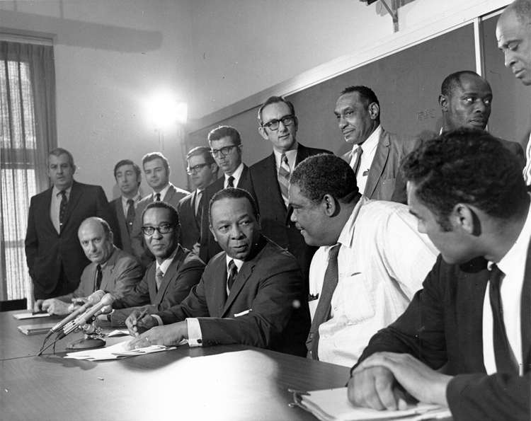 Washington, D.C. Mayor, Walter Washington, and Local 1 Chapter Chairman of Sanitary Engineering, Thurmond Hayes, sign the contract that meant 35 cents an hour for D.C. sanitation workers in May 1970.