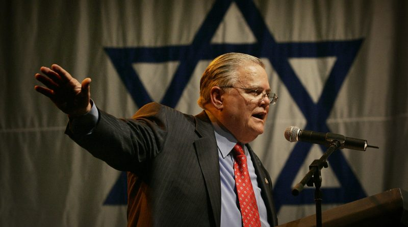 American Evangelist John Hagee addresses a crowd of his followers and Israeli supporters at a rally at the Jerusalem convention center, Sunday, April 6, 2008. Hagee on Sunday announced donations of $6 million to a number of Israeli causes and declared that Israel must remain in control of all of Jerusalem. Hagee, who has been in the news lately for his endorsement of U.S. Presidential candidate John McCain and his criticism of the Catholic Church, brought  hundreds of backers on a solidarity trip to Israel. Hagee's group, Christians United for Israel, gathered in Jerusalem to show solidarity with Israel and protest the land for peace agreements with the Palestinians. (AP Photo/Sebastian Scheiner)