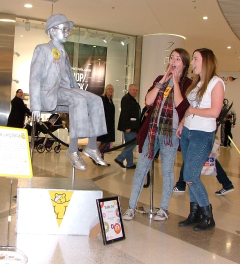 Floating human statue, ten-year-old Laughlan Muir intrigues, from left Elease Hobson, 19 and her friend 22-year-old Danielle Stewart, from Paisley.
