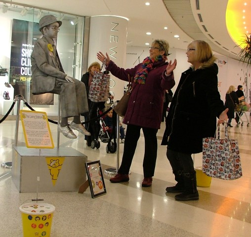 Carol Inglis, 68, and Carole Hayes, from Erskine can't quite believe their eyes when they see floating human statue, ten-year-old Laughlan Muir.
