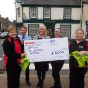 Hospice bags cash raised by carrier bag sales from Spar Lochwinnoch