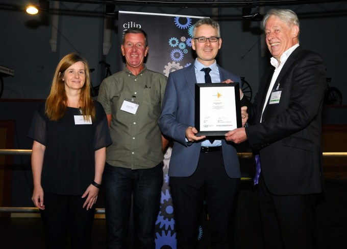 At the awards ceremony, from left are Pauline Simpson, Skoobmobile Co-ordinator, Laurence Doherty, Children and Families Mobile Library Worker, Andrew Givan, Children and Families Development Co-ordinator and John Vincent, chairman of CILIP judges