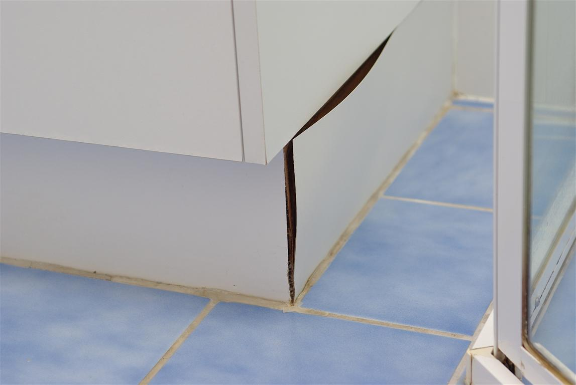kitchen vanities buy undermount sink should you tile under bathroom or cabinets water damaged vanity grouted into