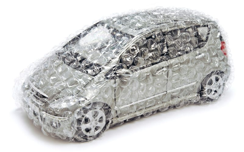 Silver Mercedes Benz toy car wrapped in transparent bubble wrap