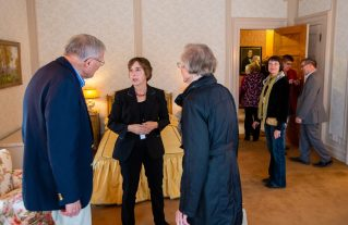 Gail Kruppa, Curator at the Torrington Historical Society, center, talks with David and Esther Bennett during a tour to celebrate the completion of the restoration of the Hotchkiss Bedroom inside the Hotchkiss-Fyler House Museum at the Torrington Historical Society on Thursday. The Bennett's were just one of the many businesses and individuals to donate to the project. Jim Shannon Republican-American