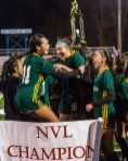 WATERBURY, CT. 07 November 2019-110719BS04 - Holy Cross players Delia Murphy (11), left, and Alyssa Hebb (16), center jump up and down celebrating their win and championship over Watertown 3-2, during the NVL Girls Soccer final between Holy Cross and Watertown at Municipal Stadium on Thursday. Bill Shettle Republican-American