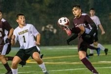 WATERBURY, CT. 07 November 2019-110719BS576 - Naugatuck's Lucas Silva (7), right, controls the ball in front of Woodland's Christian Hotchkiss (1), during the NVL Boys Soccer final between Naugatuck and Woodland at Municipal Stadium in Waterbury on Thursday. The Naugatuck boys soccer team are the 2019 NVL Champions after beating Woodland 2-1. Bill Shettle Republican-American
