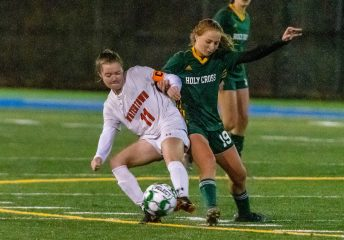 WATERBURY, CT. 07 November 2019-110719BS02 - Watertown's Morgan Dodge (11), left, and Holy Cross' Juliana Dane (19), battle for the ball, during the NVL Girls Soccer final between Holy Cross and Watertown at Municipal Stadium on Thursday. Holy Cross came from two goals down to beat Watertown 3-2. Bill Shettle Republican-American
