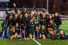 WATERBURY, CT. 07 November 2019-110719BS02 - Holy Cross' girls soccer team players erupt in celebration on the field after taking a photo raising the trophy and being crowned the 2019 NVL Champions at Municipal Stadium on Thursday. Holy Cross came back from being two goals down to beat Watertown 3-2 . Bill Shettle Republican-American