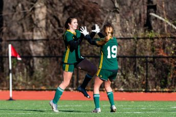 WATERBURY, CT. 16 November 2019-111619BS470 - Holy Cross' Sophia Vescera (7), left, celebrates her scoring of a goal with teammate Juliana Dane (19), during a Class S quarterfinal match between Coventry and Holy Cross at Crosby High School in Waterbury on Saturday. Holy Cross beat Coventry 3-0 and advances to the Class S semi-finals next week. Bill Shettle Republican-American