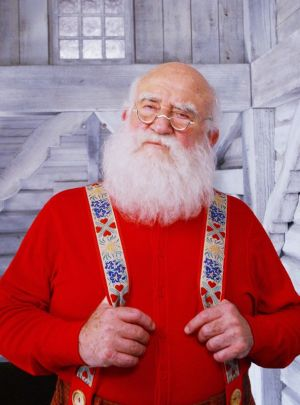 Ed Asner as Santa in 'Elf. TNS