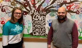 Megan Cremers, case manager, and Jered Bruzas, shelter director, await the walkers in the Shelter dining room.