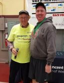 Jim Mulhall, perennial contender in this event and pictured here with Race Director Roy Cavanaugh, won the Gold Medal in the 'Young at Heart' age group.