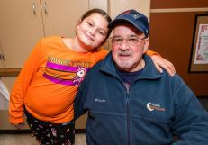 Kayla Derouin, 11, and her grandfather Ted Derouin both of Waterbury enjoy themselves, at the Hopeville Church's annual fundraiser dinner and silent auction at the Hopeville Church in Waterbury on Wednesday. Bill Shettle Republican-American