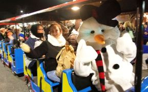 A snowman sits upfront of the Roaming Railroad in the parade during the annual Light Up Thomaston Christmas celebration in Thomaston Saturday. Steven Valenti Republican-American