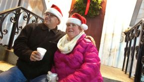 Tim Ceritello and Faith Brazee both of Plymouth enjoy hot chocolate outside St. Peter's Trinity Church waiting for the parade during the annual Light Up Thomaston Christmas celebration in Thomaston Saturday. Steven Valenti Republican-American