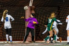 NAUGATUCK, CT. 20 November 2019-112019BS867 - Holy Cross' Juliana Dane (19), right, watches her shot sail over the head of Litchfield's goalkeeper Molly Lennon for a goal, during the Girls Soccer Class S semifinal match between Litchfield and Holy Cross at Naugatuck High School on Wednesday. Holy Cross beat Litchfield 3-1 and advance to the Class S final this Saturday. Bill Shettle Republican-American