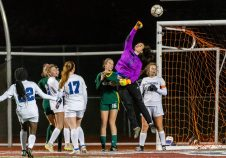 NAUGATUCK, CT. 20 November 2019-112019BS878 - Litchfield goalkeeper Molly Lennon bats the ball out of the goalie area, during the Girls Soccer Class S semifinal match between Litchfield and Holy Cross at Naugatuck High School on Wednesday. Holy Cross beat Litchfield 3-1 and advance to the Class S final this Saturday. Bill Shettle Republican-American