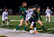 NAUGATUCK, CT. 20 November 2019-112019BS864 - Litchfield's Fran Luzzi (5), center, tries to control the ball against Holy Cross players Ella Atkins (21), left, and Jenna Debiase (15), during the Girls Soccer Class S semifinal match between Litchfield and Holy Cross at Naugatuck High School on Wednesday. Holy Cross beat Litchfield 3-1 and advances to the Class S final this Saturday. Bill Shettle Republican-American