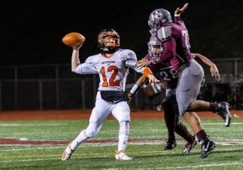 NAUGATUCK, CT. 21 November 2019-112119BS396 - Watertown quarterback Xavier Powell (12), throws the ball downfield under the heavy rush of Naugatuck's Kyle Johnson (28) and Syed Ahmad (71), during a NVL Football game between Watertown and Naugatuck at Naugatuck High School on Thursday. Bill Shettle Republican-American
