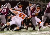 NAUGATUCK, CT. 21 November 2019-112119BS419 - Watertown's Matthew Hardisty (69) tries to stop Naugatuck's Aaron Smith (48) by grabbing his shirt, during a NVL Football game between Watertown and Naugatuck at Naugatuck High School on Thursday. Bill Shettle Republican-American