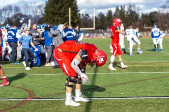 CHESHIRE, CT. 28 November 2019-112819BS1268 - Cheshire's William Bergin (59) reacts on the field in dejection after his team lost to Southington 21-20 in double overtime, during a SCC game and the annual Cheshire vs Southington Thanksgiving game called the Apple Valley Classic at Cheshire High School on Thursday.