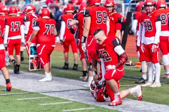 CHESHIRE, CT. 28 November 2019-112819BS1272 - Cheshire's Jacob Dubois (42) kneels along the sidelines in disappointment after Cheshire lost to Southington 21-20 in double overtime, during a SCC game and the annual Cheshire vs Southington Thanksgiving game called the Apple Valley Classic at Cheshire High School on Thursday. Bill Shettle Republican-American