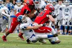 CHESHIRE, CT. 28 November 2019-112819BS1249 - Southington's Anthony Henderson (24), left, makes a play stopping Cheshire's Jake McAlinden(43), right, behind the line of scrimmage, during a SCC game and the annual Cheshire vs Southington Thanksgiving game called the Apple Valley Classic at Cheshire High School on Thursday. Southington won 21-20 in double overtime. Bill Shettle Republican-American