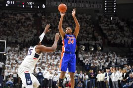 Florida's Kerry Blackshear Jr., right, shoots against Connecticut's Josh Carlton during the first half of an NCAA college basketball game, Sunday, Nov. 17, 2019, in Storrs, Conn. (AP Photo/Jessica Hill)