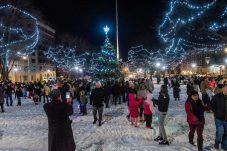 WATERBURY, CT. 08 December 2019-120819BS19 - People gather on the green taking photos, after the annual lighting of the Christmas Tree and surrounding lights on the City Green to help launch the Holiday Season in downtown Waterbury on Sunday. The lighting ceremony was pushed backed on week due to the snowstorm last weekend. Bill Shettle Republican-American