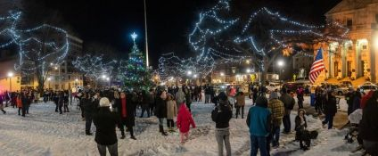 WATERBURY -- People gather on the green taking photos, after the annual lighting of the Christmas Tree and surrounding lights on the City Green to help launch the Holiday Season in downtown Waterbury on Sunday. The lighting ceremony was pushed backed on week due to the snowstorm last weekend. Bill Shettle Republican-American